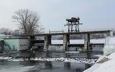 Dam in winter, water dam construction, — Stock Photo