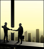 Builders shaking hands — Stock Vector