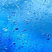 Blå bakgrund med vatten droppar konsistens — Stockfoto