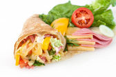 Thin pancakes with ham, cheese and vegetables — Stock Photo