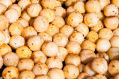 Many roast round small potatos — Stock Photo