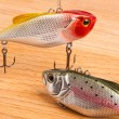 Bait for fishing - wobbler on light wood — Stock Photo