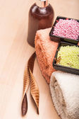 Colored sea salt and towels for spa — Stock Photo