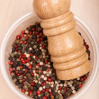 Stock Photo: Different peppercorn in bowl with pepper mill