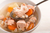 Fish soup with salmon and orge perle in spoon — Stock Photo