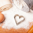 Pastry, rolling pin, eggs and figures for cookies — Stock Photo