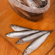 Stock Photo: Salted anchovies in box on wooden