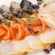 Close-up snack made dish from slice fish — Stock Photo