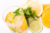Fresh cold cocktail in glass with sliced citus — Stock Photo