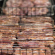 Uncooked meat steak in grilled barbecue — Stock Photo