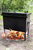 Mobile camp smokehouse warm on wood and fire — Stock Photo