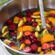 Mixed punch with fruits in metal bowl — Stock fotografie