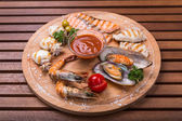 Snack from seafood - fish, cuttlefish, shrimp, mussel on wood — Stock Photo