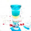 Short blue coctail with ice and color drops — Stock Photo