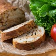 Stock Photo: White sliced homemade baguette with dried tomatoes