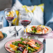 Salad with salmon and verdure in plate on table with blue chair — Stock Photo