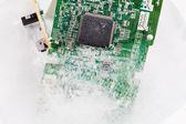 Frozen electonics board for pc in ice — Stock Photo