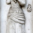Old vintage bas-relief with woman holding the umbel — Stock Photo