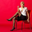 Young schoolmarm sitting on the chair — Stock Photo #13194776