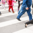Pedestrians in a crosswalk — Stock Photo