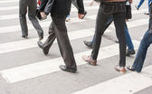 Legs of pedestrians in a crosswalk — Stock Photo