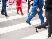 Pedestrians in a crosswalk — Stock Photo