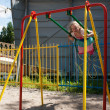 Girl swinging on a swing — Stock Photo #29372635