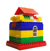 Toy house out of colored blocks — Stock Photo