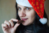 Portrait of a beautiful young woman in a christmas cap — Stock Photo