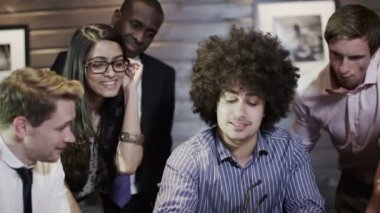 Enthusiastic young business group in a meeting — Stock Video