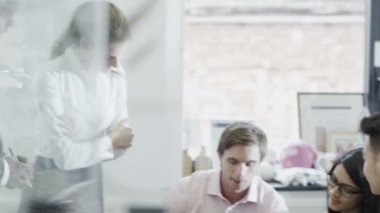 Attractive young creative business team in a meeting in contemporary office — Stock Video
