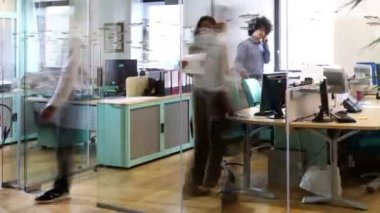 Attractive young professionals at work in busy modern office — Stock Video