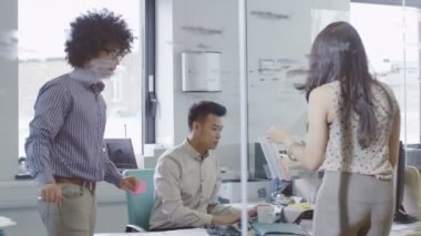 Young creative business team working together in a light contemporary office — Stock Video