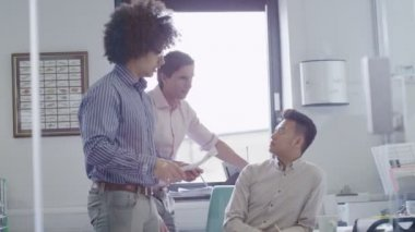 Young male business team working together in a light contemporary office — Stock Video