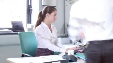 Attractive fashionable young professionals at work in busy office — Stock Video