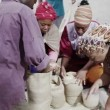 African family working together, measuring out quantities of rice or grain — Stock Video
