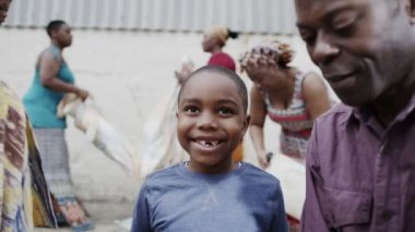 Portrait of happy smiling african boy with his family and community members — Stock Video