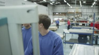 Cheerful factory or warehouse workers checking the machinery — Stock Video