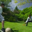 Cute young boy playing sports with his father, in the garden on a summer day — ストックビデオ