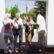 Generations of a family embrace outside the family home — Stock Video