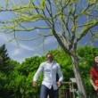 Happy asian family playing sports and having fun in the garden on a summer day — Stok video