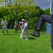 Family and friends of many generations playing sports in the garden on a sunny day — Stock Video #44377263