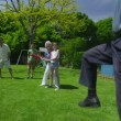Family and friends of many generations playing sports in the garden on a sunny day — Stock Video #44377661