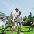 Family and friends of many generations playing sports in the garden on a sunny day — Stock Video #44377873