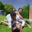 Happy asian family playing sports and having fun in the garden on a summer day — Vídeo Stock