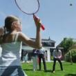 Family and friends of many generations playing sports in the garden on a sunny day — Stock Video #44378087