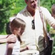 Loving father returns home from a trip to be greeted by his family — Vídeo Stock