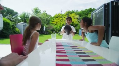 Happy group of young friends play together outdoors in the summer time — Stockvideo