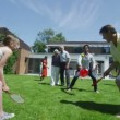 Family and friends of many generations playing sports in the garden on a sunny day — Stock Video #44380129