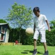 Cute young boy playing sports with his father, in the garden on a summer day — 图库视频影像